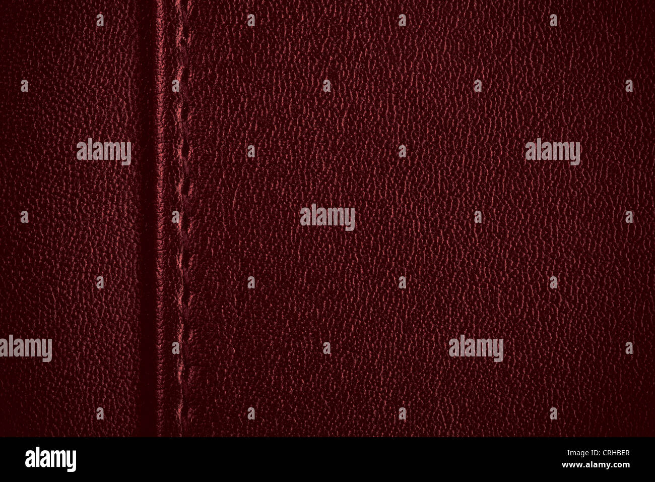 red leather texture, seam between margin and background - Stock Image