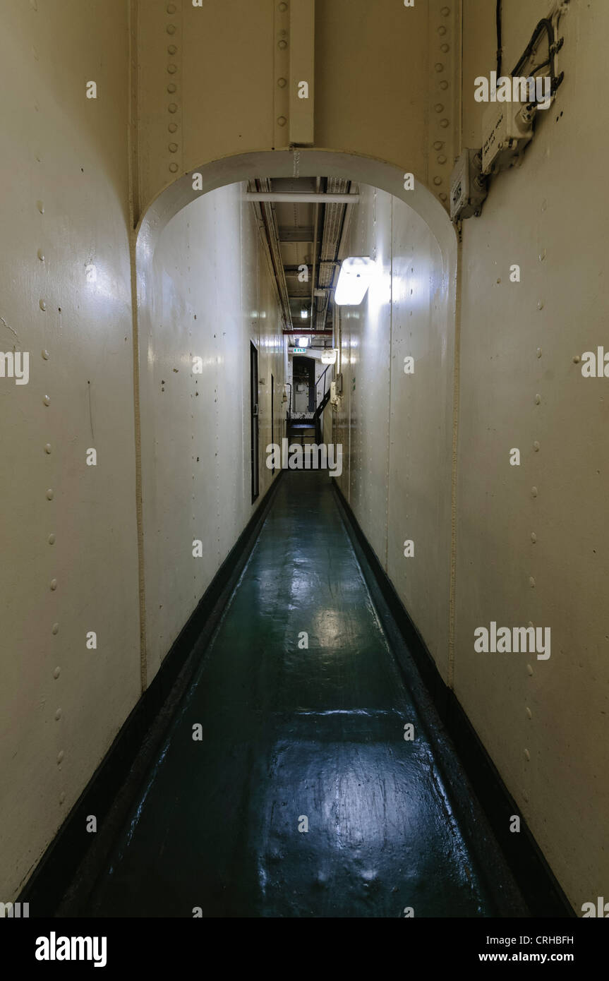 Corridor below decks in a ship built in the early 1900s. - Stock Image