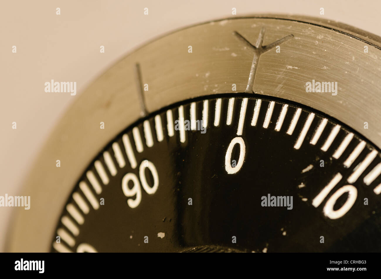 Closeup of a combination lock on a military-grade secure safe with the dial set to 0 - Stock Image