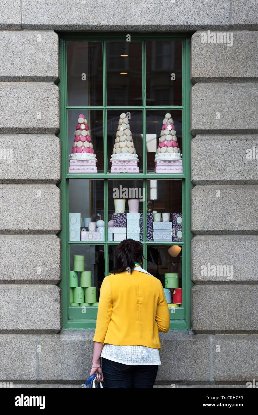 Woman looking in the window of Laduree shop. Covent Garden, London, England - Stock Image
