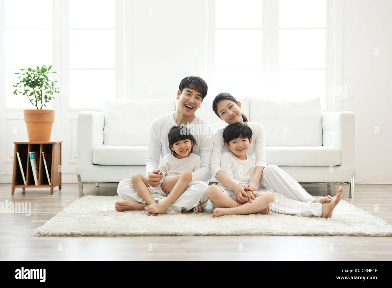 Harmonious Family In Living Room Stock Photos & Harmonious Family In ...