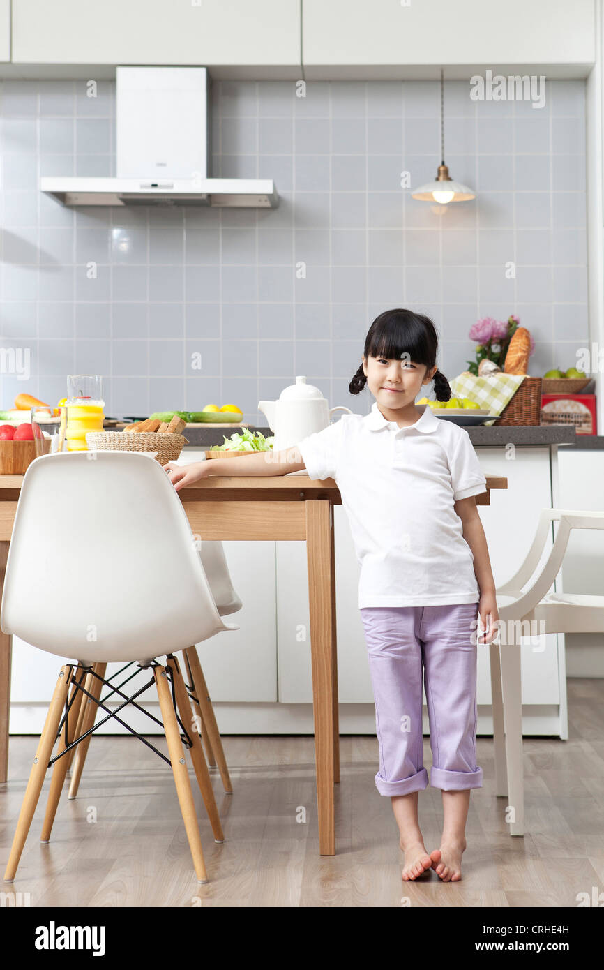 Surprising Little Girl Standing In Kitchen Stock Photo 48942113 Alamy Creativecarmelina Interior Chair Design Creativecarmelinacom