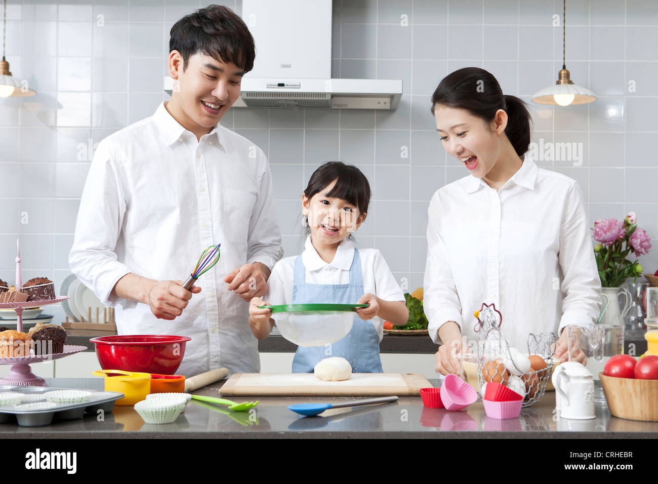 Happy family cooking in the kitchen Stock Photo: 48942315 - Alamy