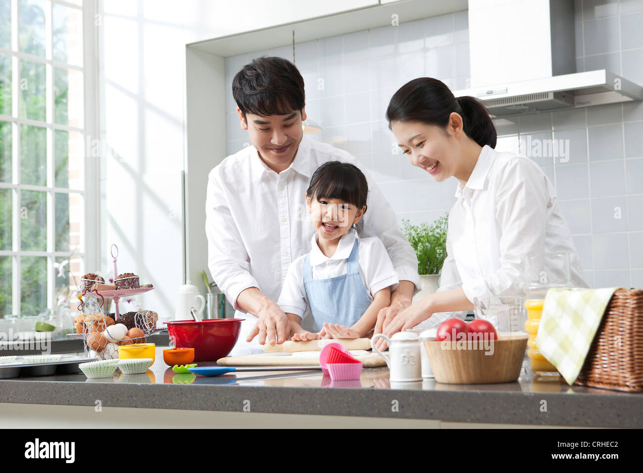 Happy family cooking in the kitchen Stock Photo: 48942322 - Alamy