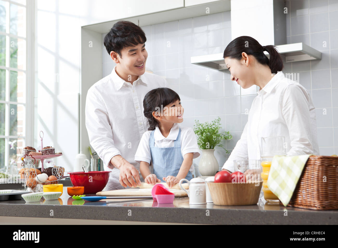 Happy family cooking in the kitchen Stock Photo: 48942324 - Alamy