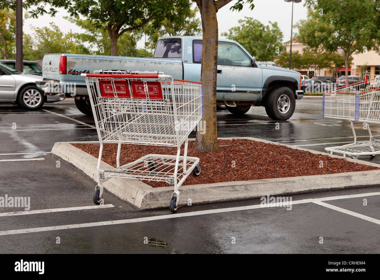 Shopping carts left in the parking lot - Stock Image