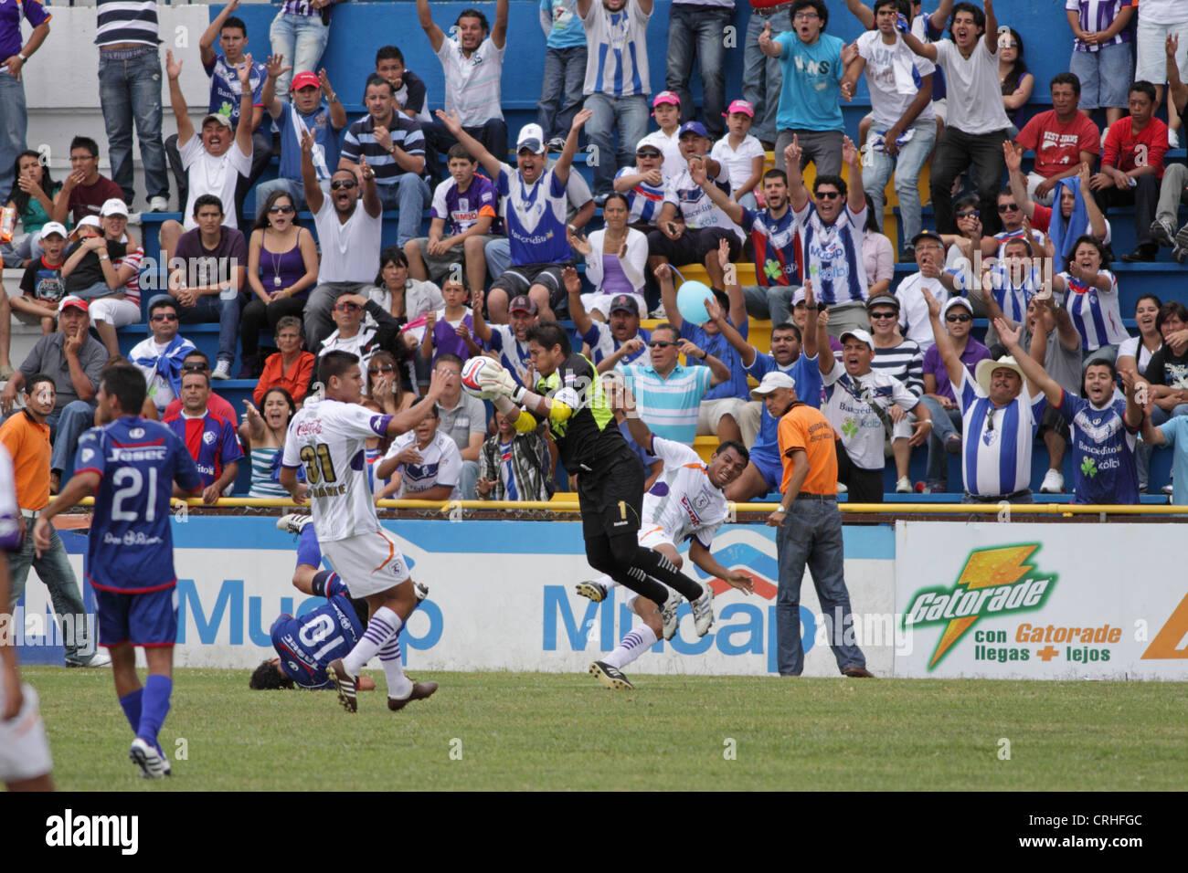 Football / soccer match between Saprissa and Cartago in the Cartago stadium, Costa Rica. - Stock Image