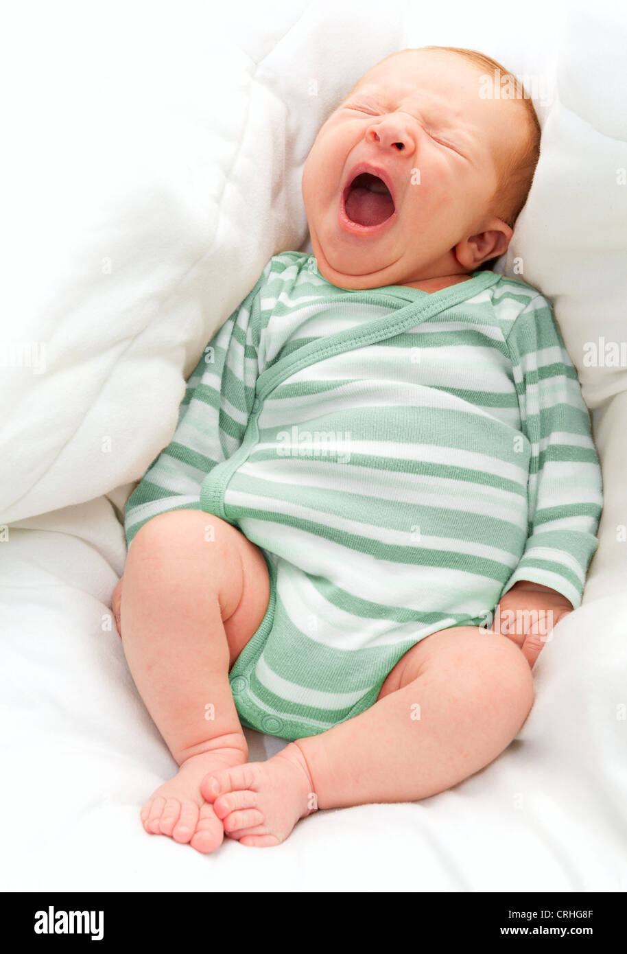 Yawning New Born Baby in the Bed - Stock Image