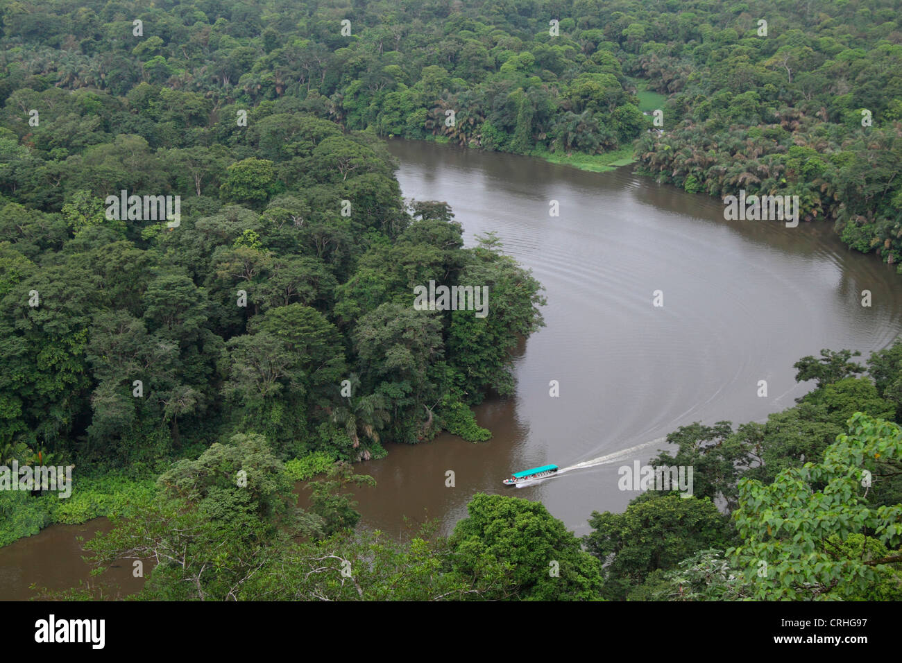 Tourist boat on natural rainforest canal from Tortuguero Hill (Cerro Tortuguero). Barro Colorado Wildlife Refuge. - Stock Image