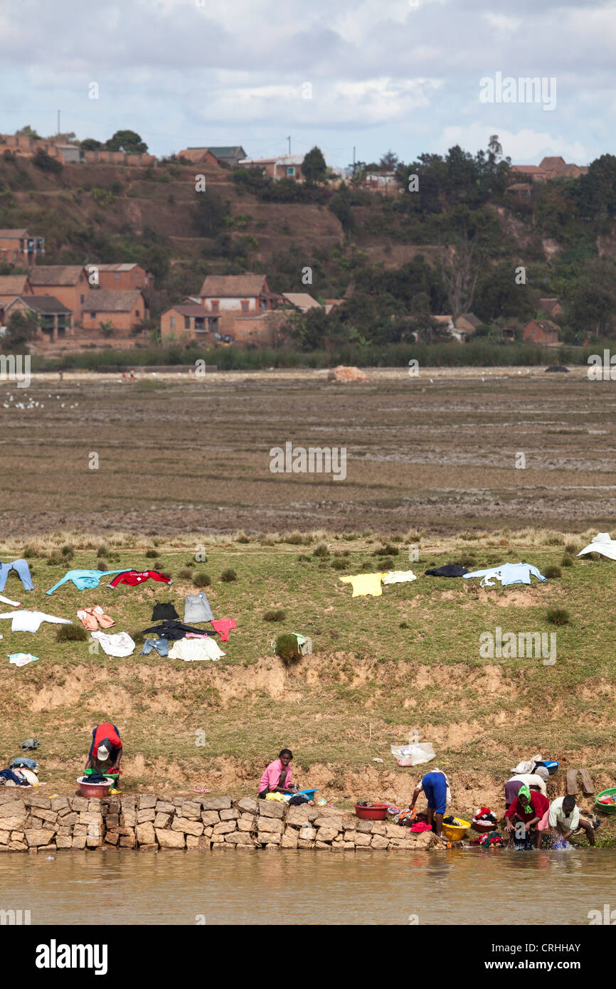 laundry drying on riverbank on the outskirts of Antananarivo, Madagascar - Stock Image