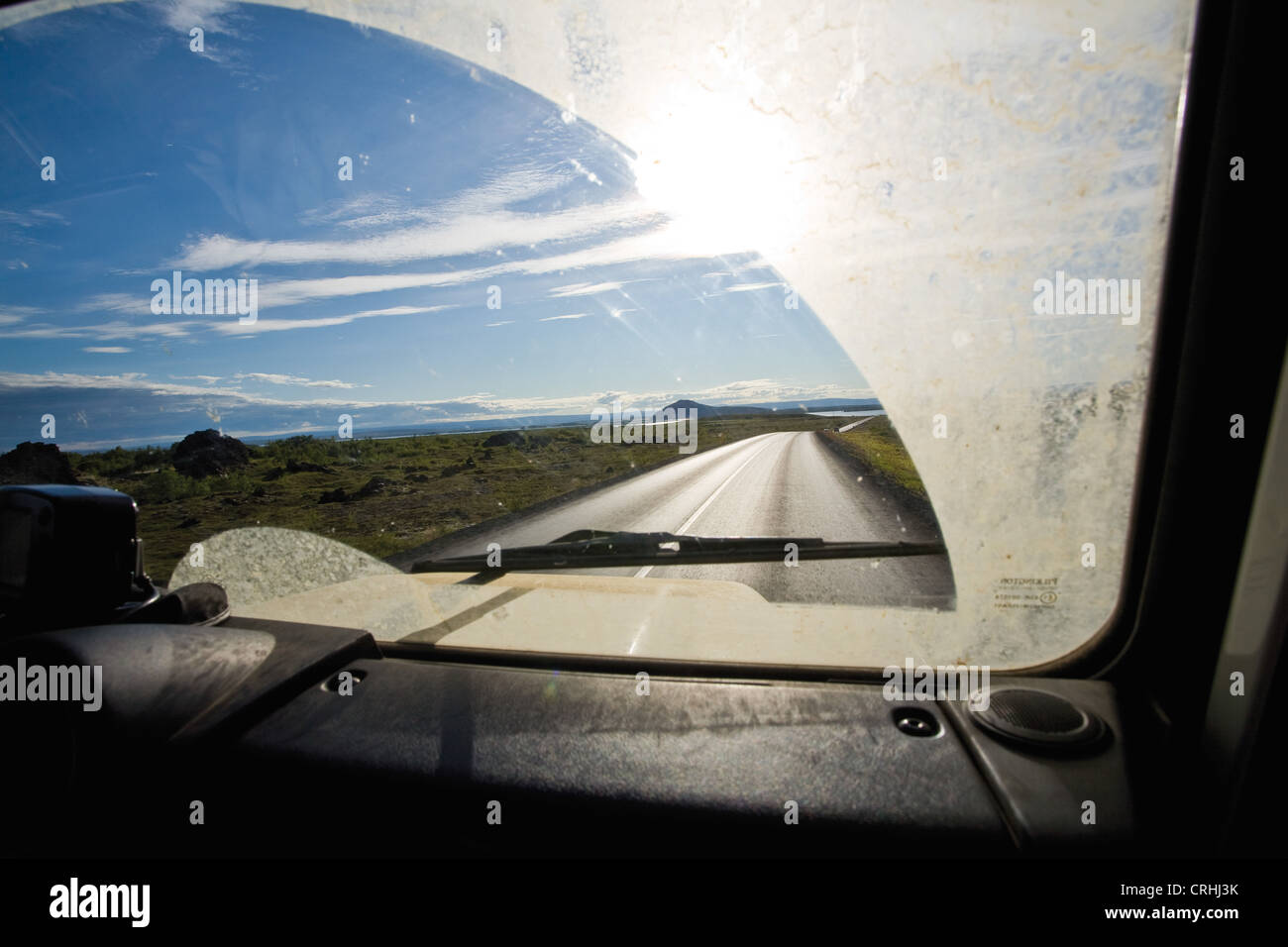 Country road viewed through car windshield - Stock Image