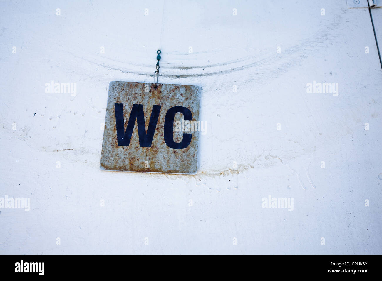 Restroom sign marked 'WC' - Stock Image