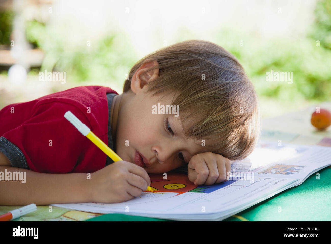 Boy coloring with markers Stock Photo: 48946223 - Alamy
