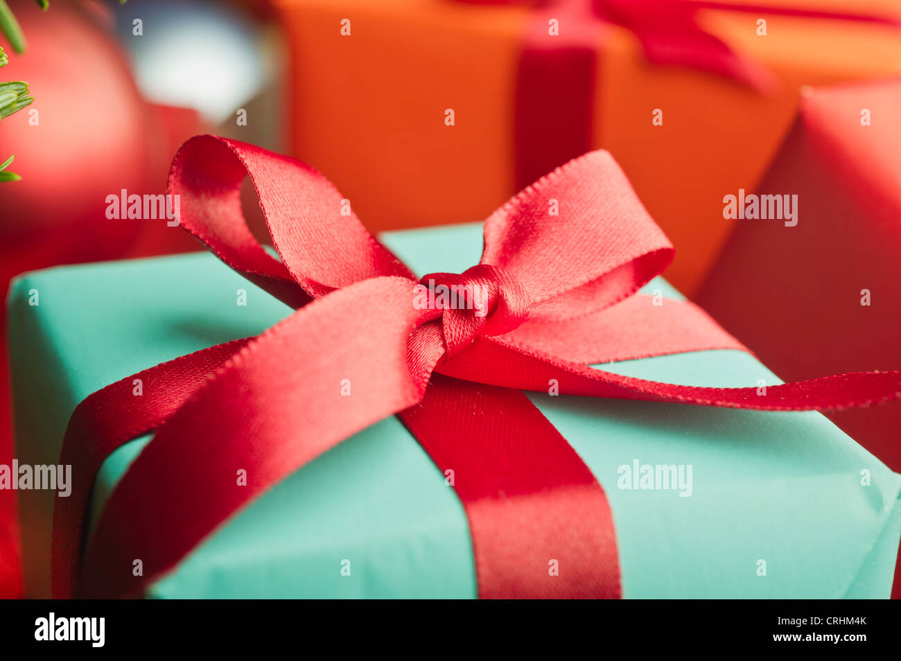 Festively wrapped Christmas gift, close-up - Stock Image