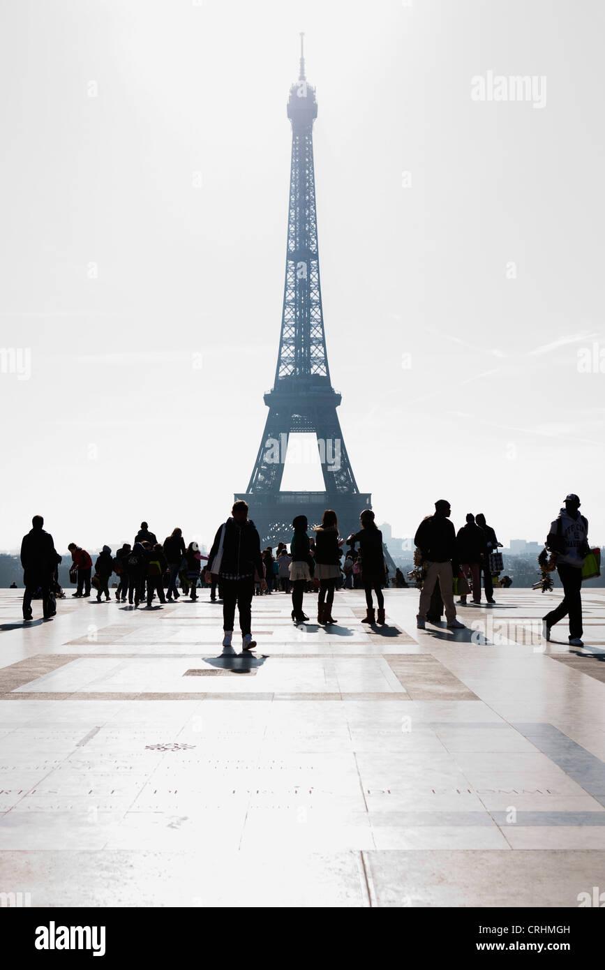 Tourists view Eiffel Tower from Palais de Chaillot, Paris, France - Stock Image