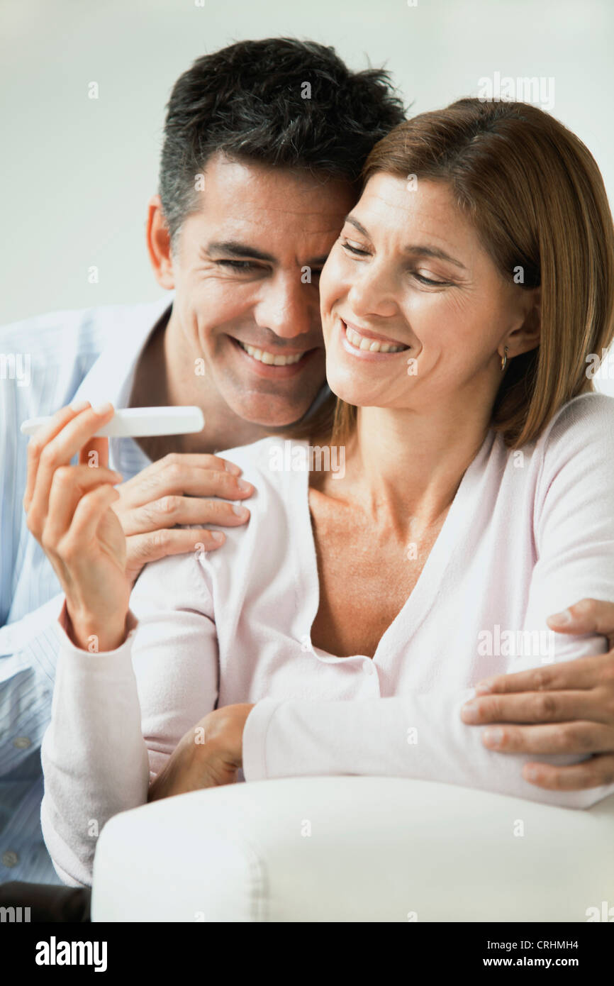 Couple pleased with pregnancy test result - Stock Image