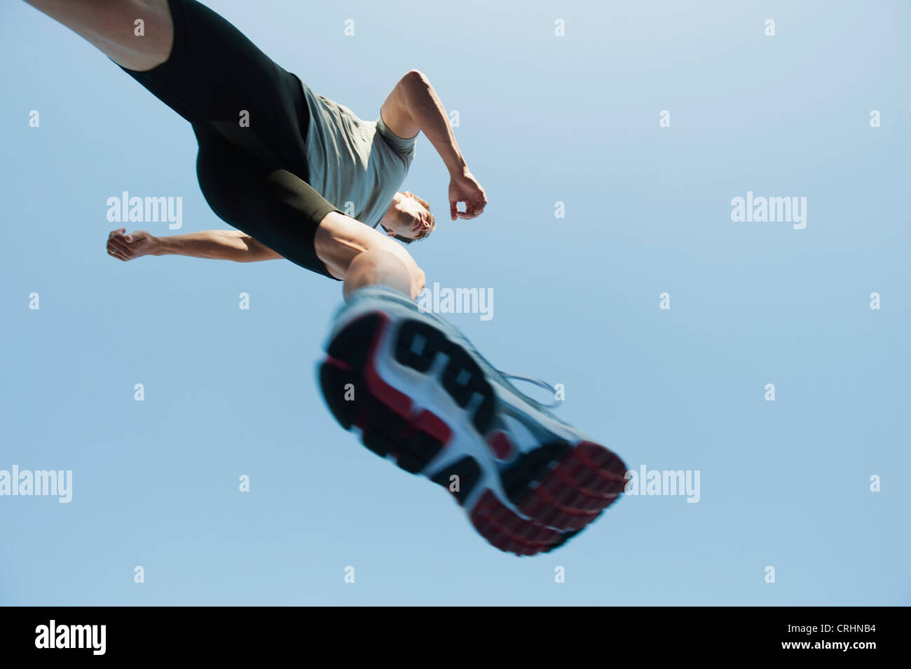 Runner in mid-stride, viewed from directly below Stock Photo