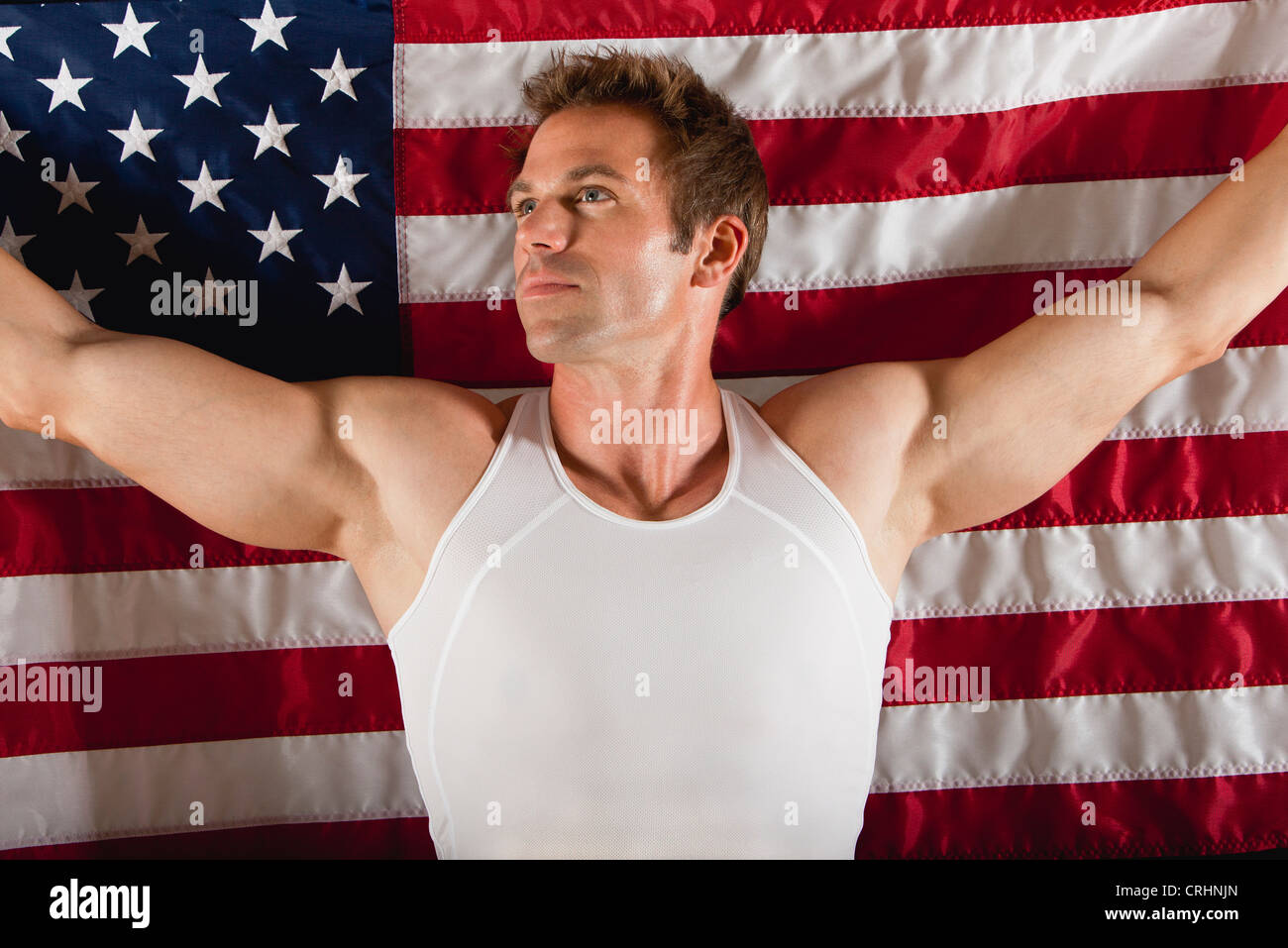 Male athlete in front of American flag - Stock Image