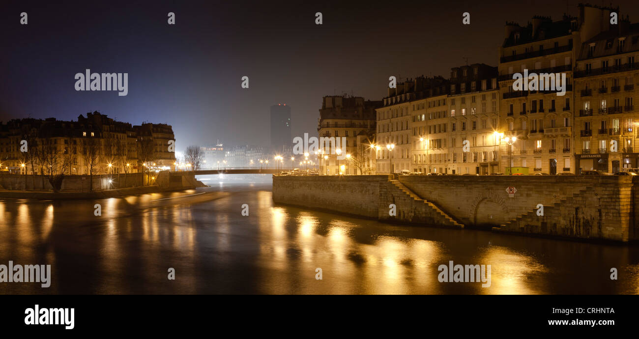 France, Paris, Seine River at night - Stock Image