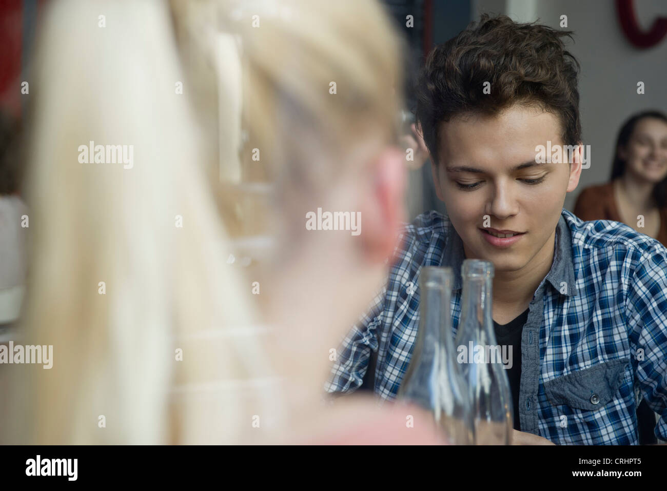 Young man in cafe with friend - Stock Image