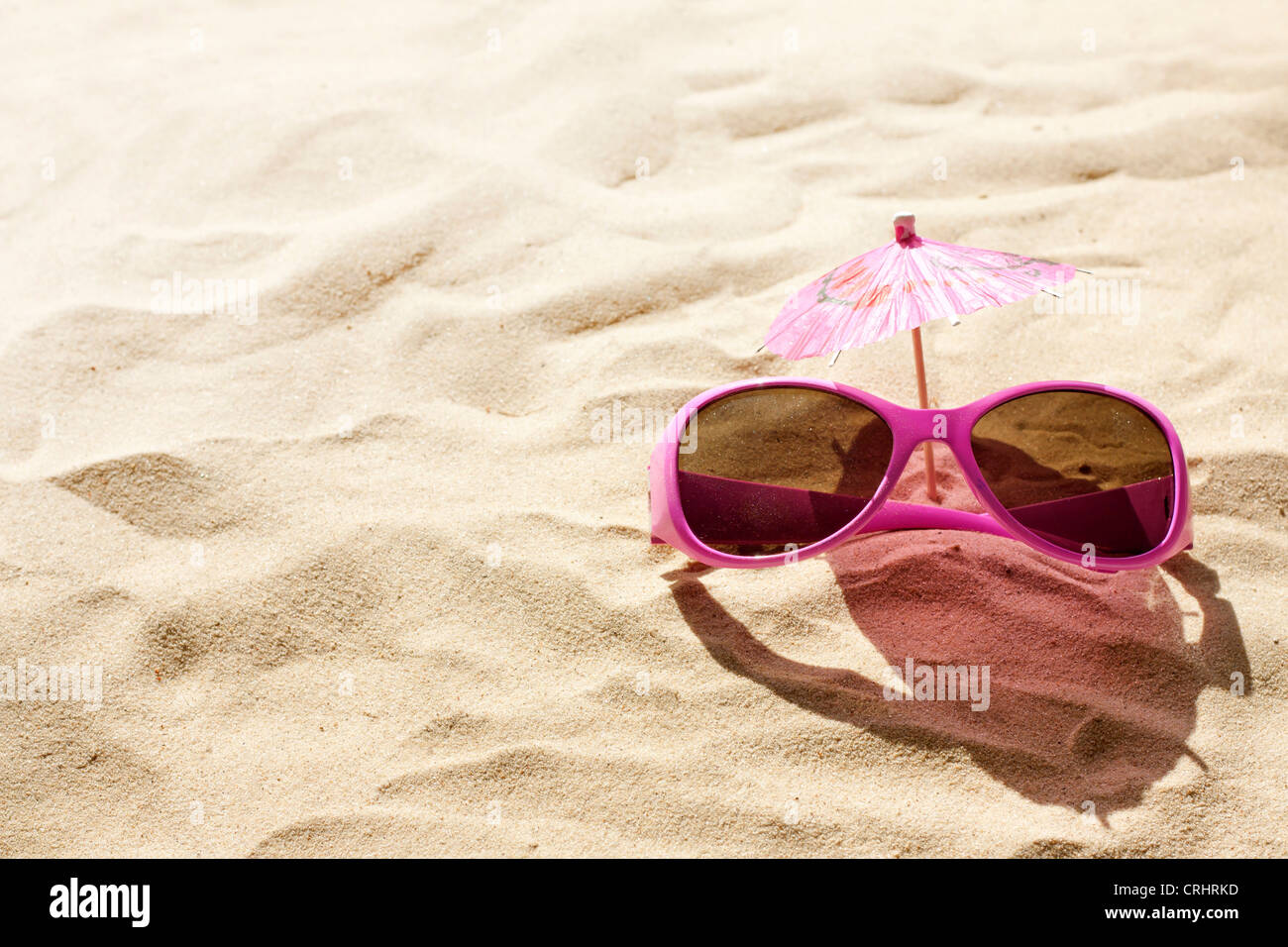 sunglasses on beach in sand holiday hot day concept - Stock Image