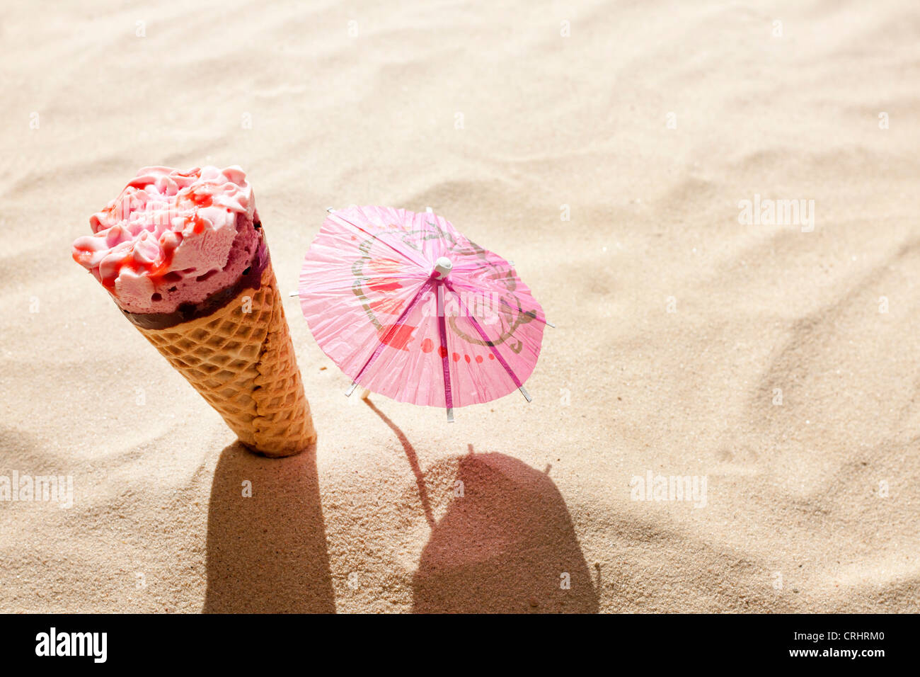 ice cream on beach in sand concept of hot day - Stock Image