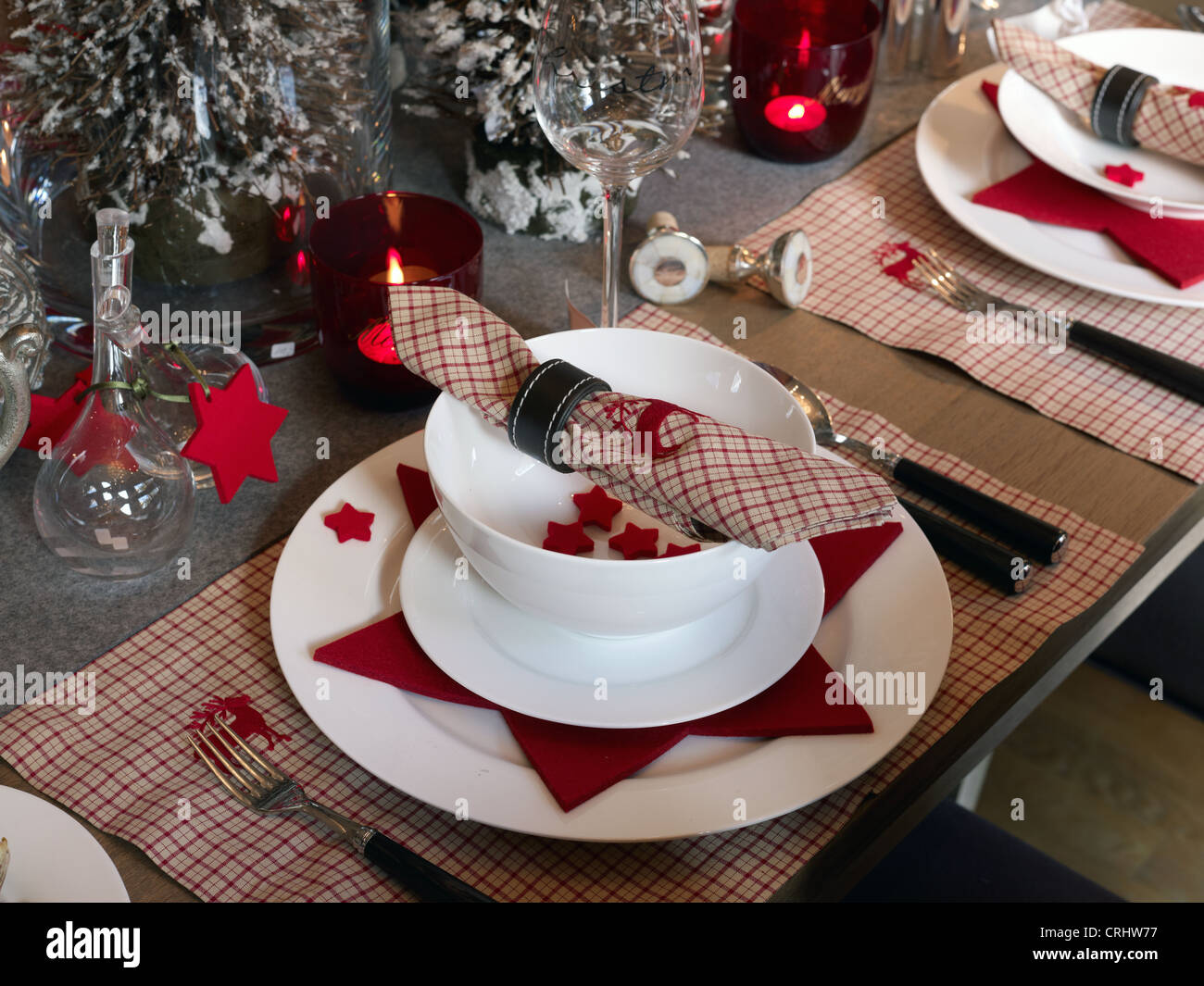 Well-laid table with Christmas decoration - Stock Image