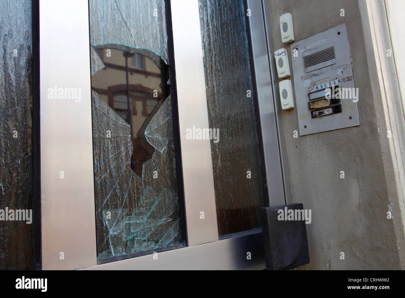 demolished house entrance with broken glass plate and doorbell panel, Germany - Stock Image