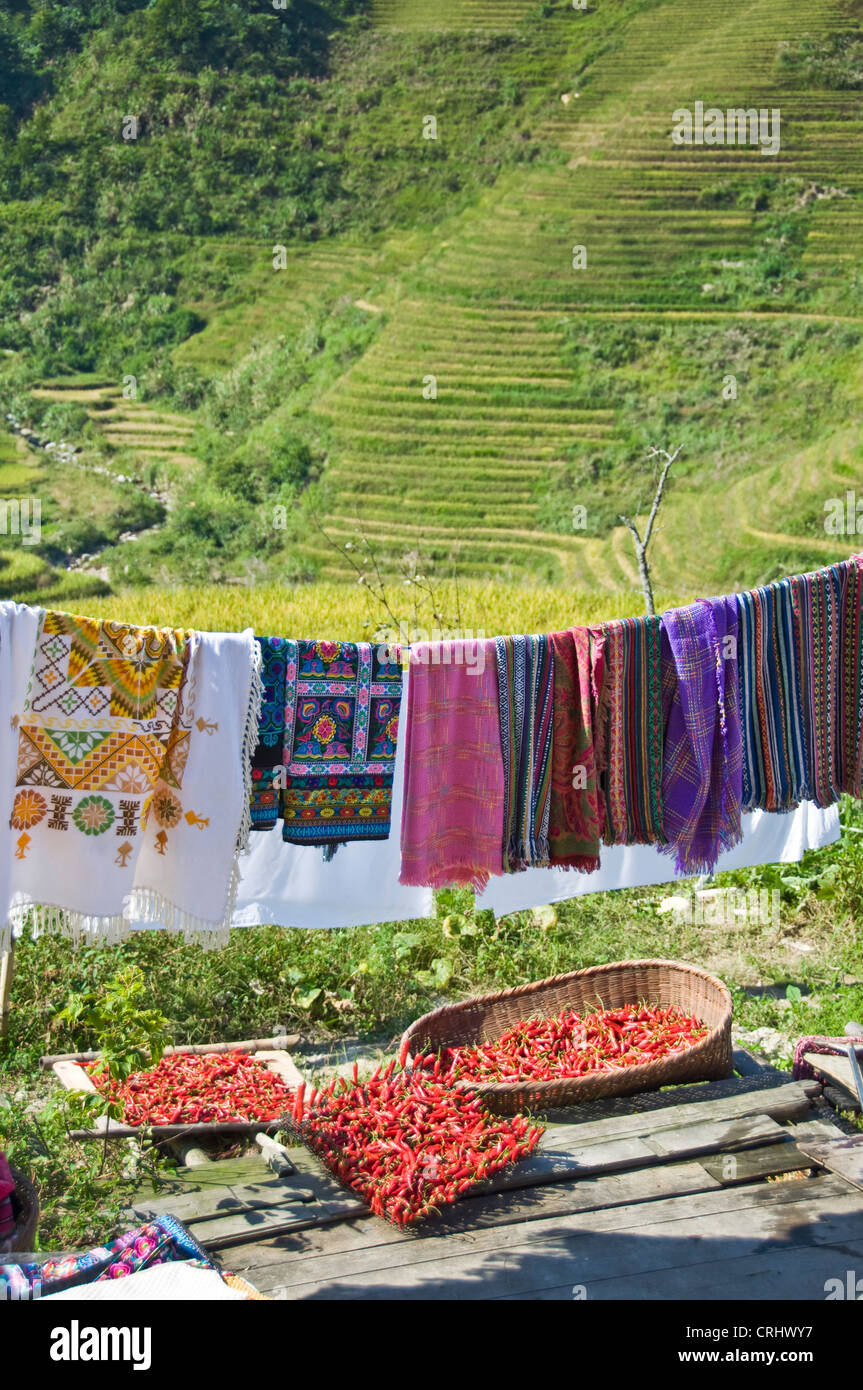 Laundry hanging and red chilies drying in Longji village -  Guangxi province - China Stock Photo