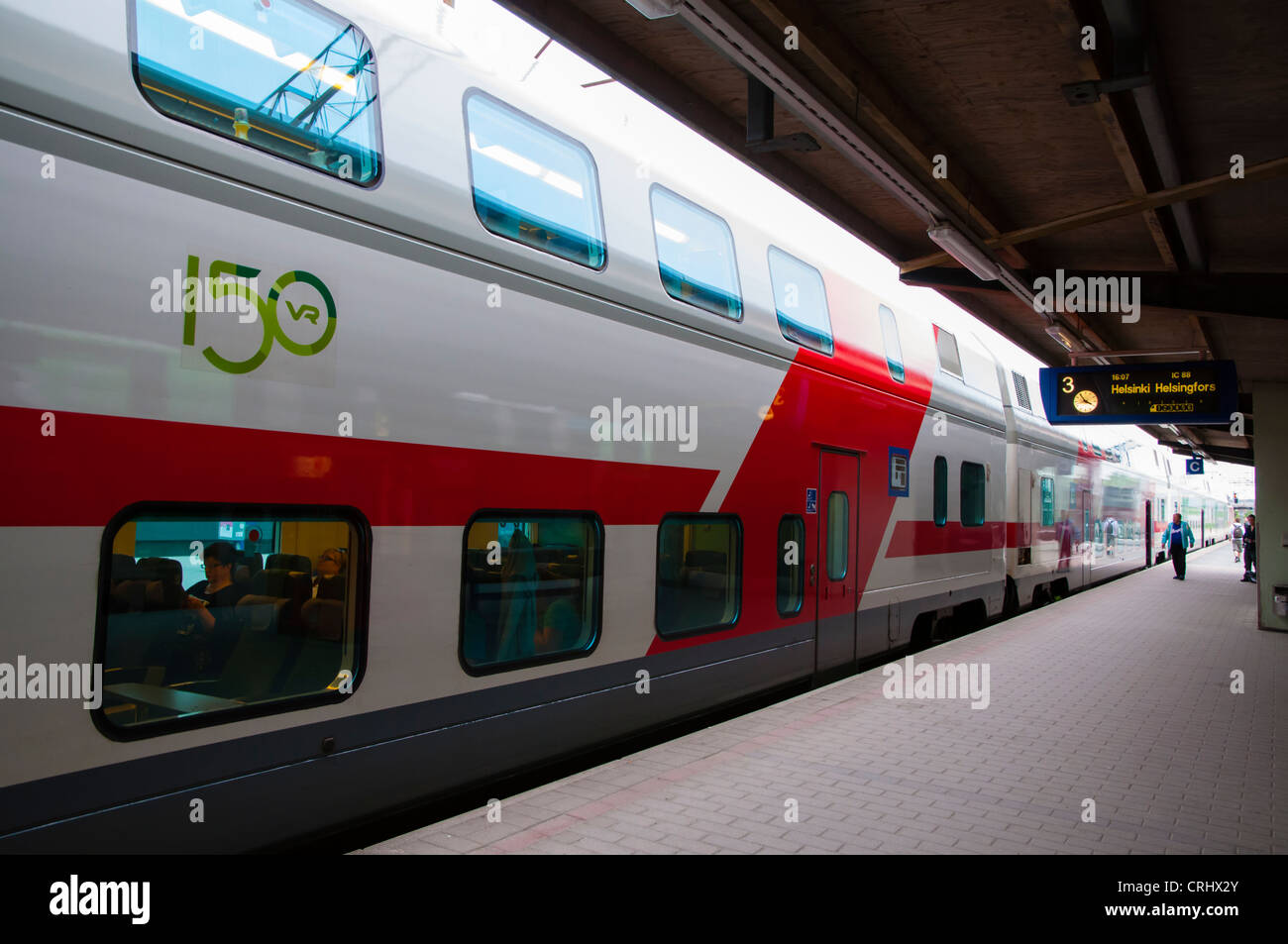 Two storey train at railway station Tampere Finland Europe - Stock Image