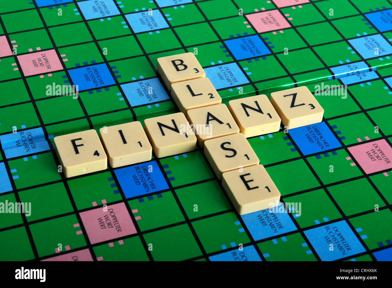 the words 'Finanz' and 'Blase' laid on a Scrabble field - Stock Image