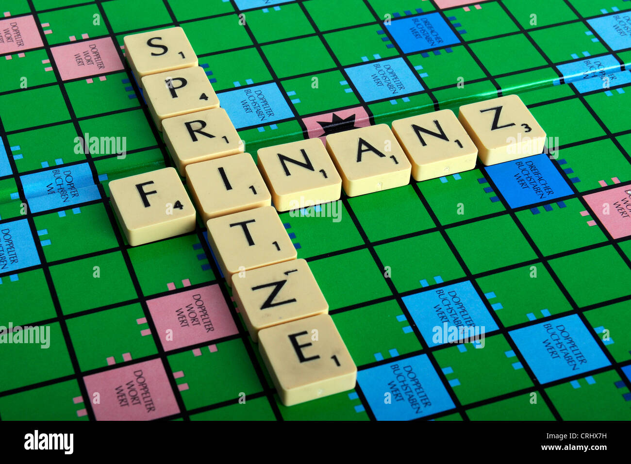 Scrabble field with the words 'Finanz' and 'Spritze', the 'Z' in the latter incorrectly - Stock Image