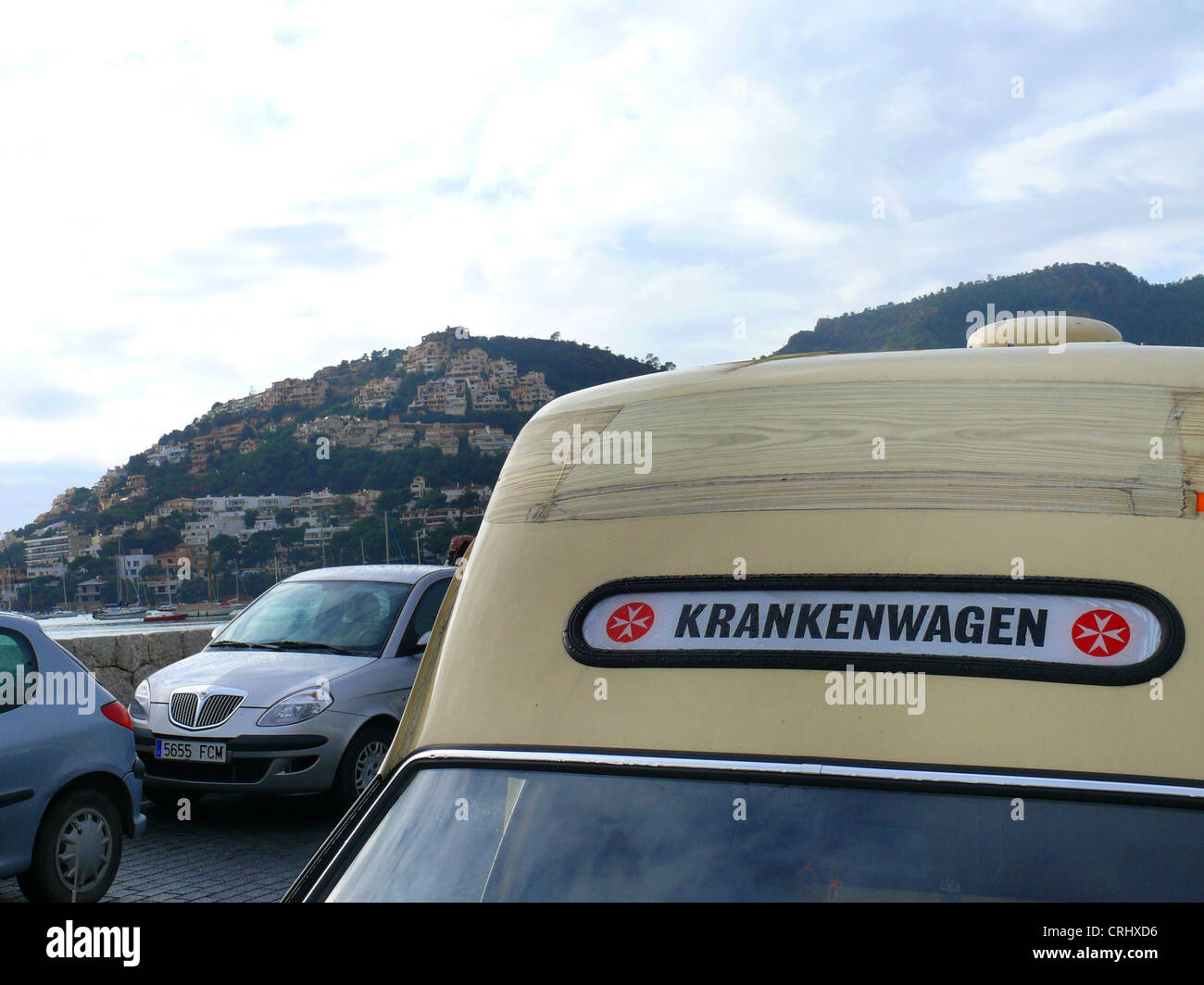 dated German ambulance car parking at harbour, Spain, Balearen, Majorca, Port Andratx - Stock Image