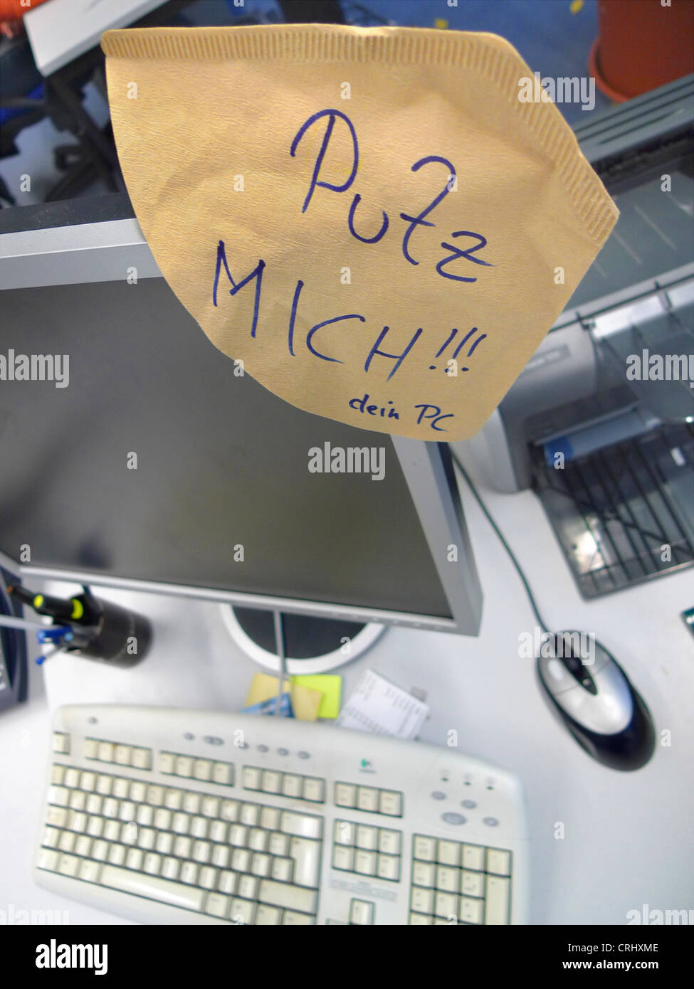 joke by a an office colleague, demand for cleaning the PC, tidy me up! - Stock Image