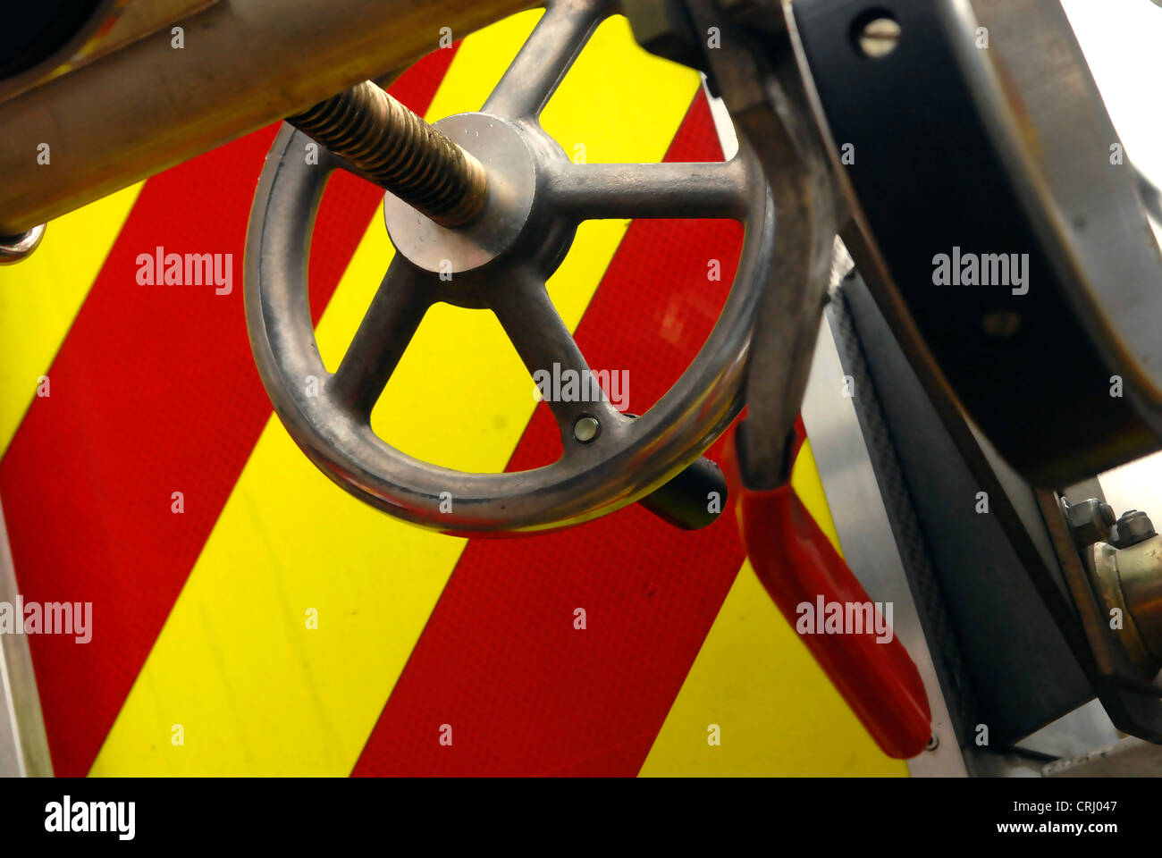 A valve on a fire engine used to control the flow of water through the firemens hose. - Stock Image
