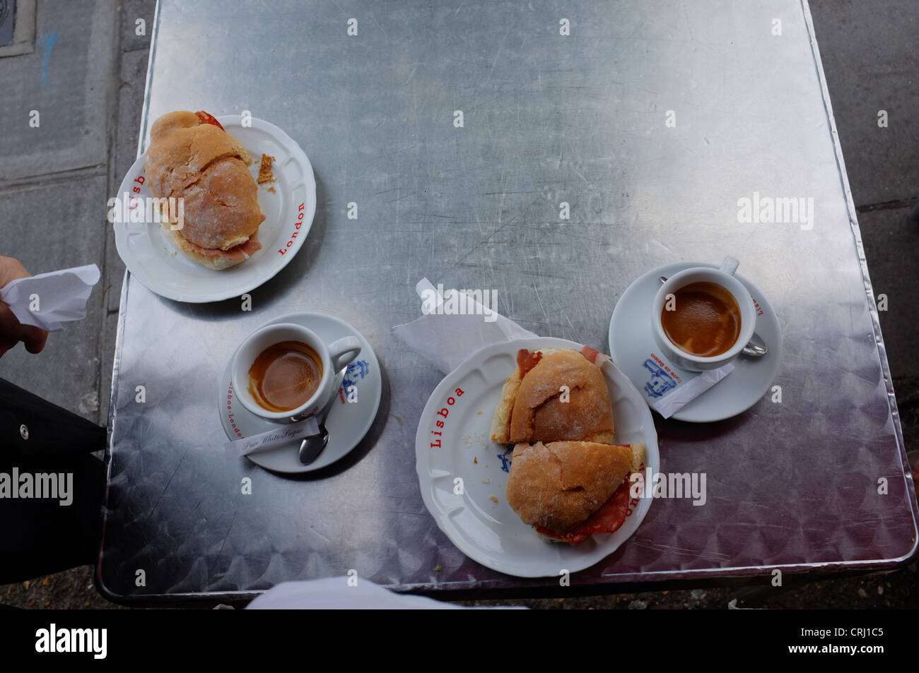 An outside Portuguese breakfast at the Lisboa Patisserie in Golbourne Road, North Kensington, London - Stock Image