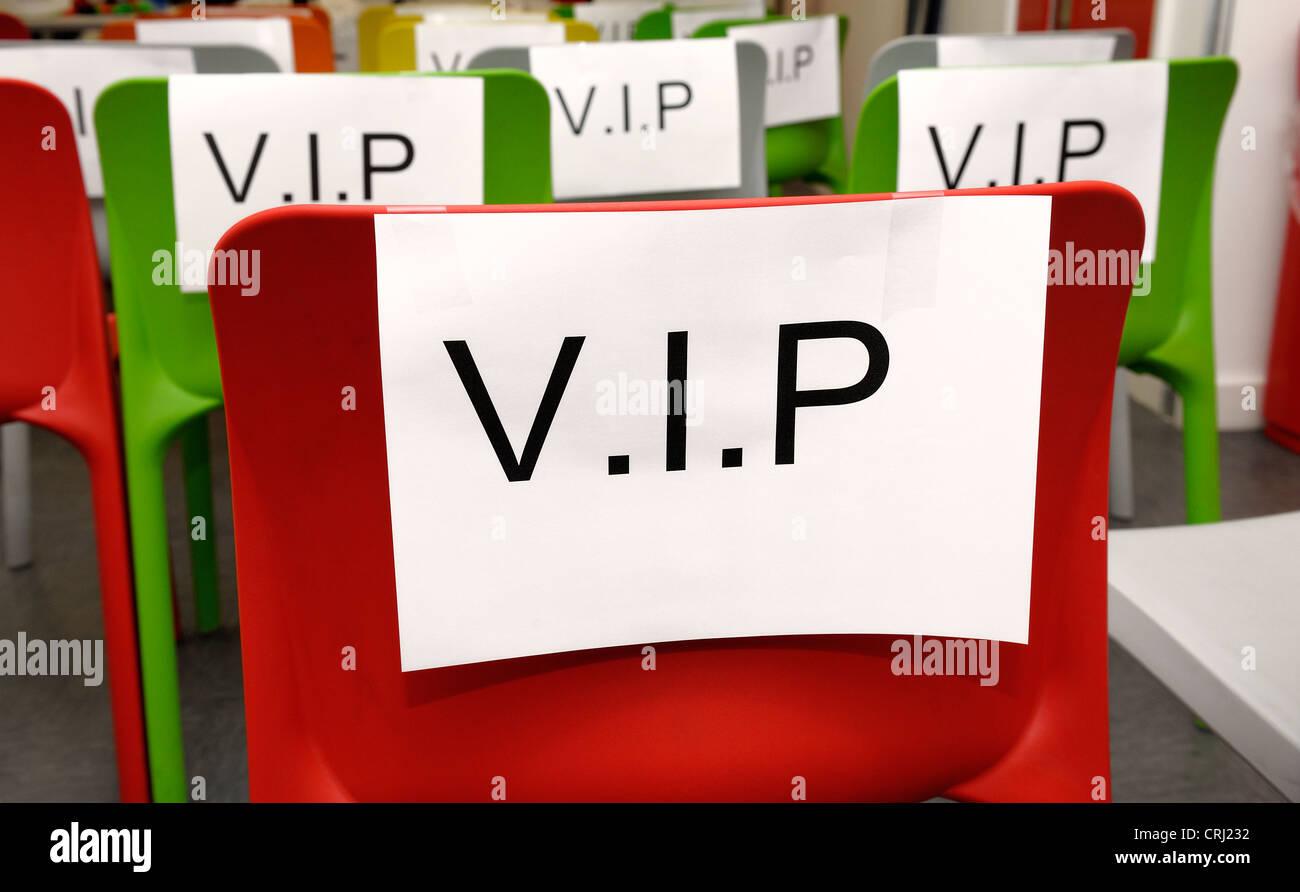 coloured seats labeled v.i.p. - Stock Image