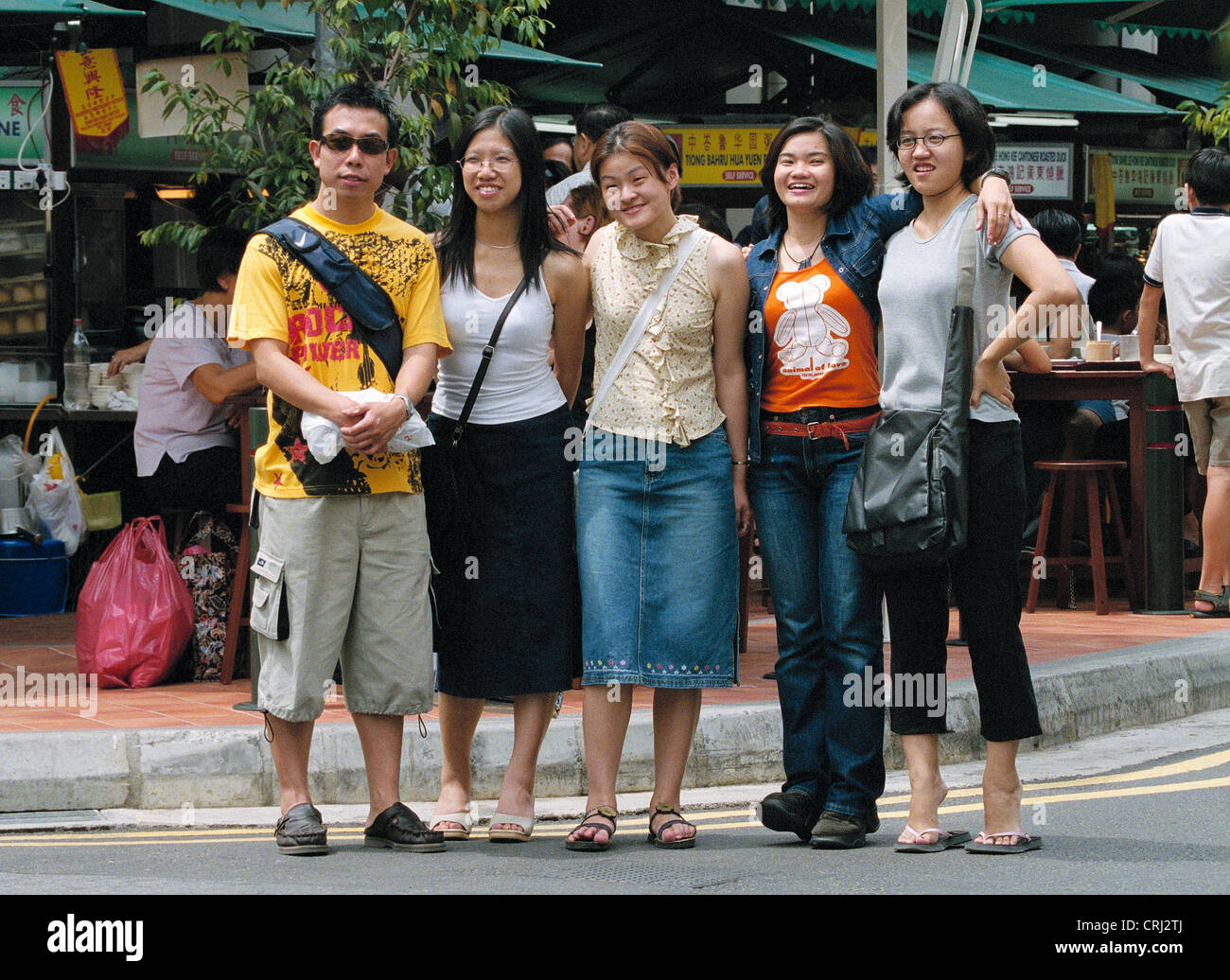 A group photo on a street in Singapore's Chinatown - Stock Image