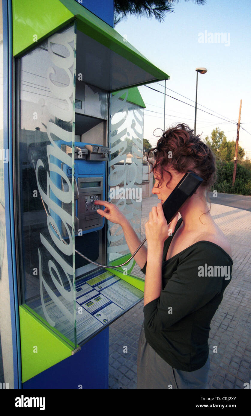 Woman in phone booth Telefonica - Stock Image