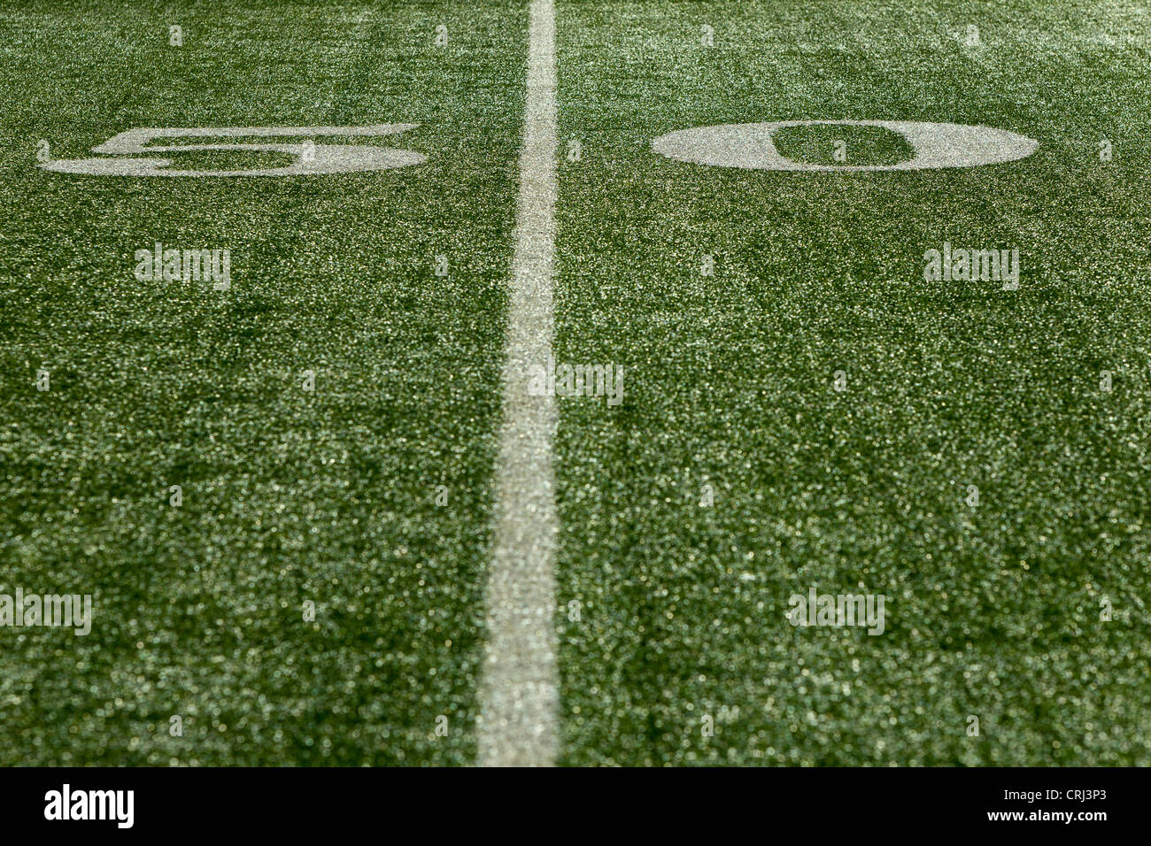 50 yard line marker in American Football stadium. - Stock Image