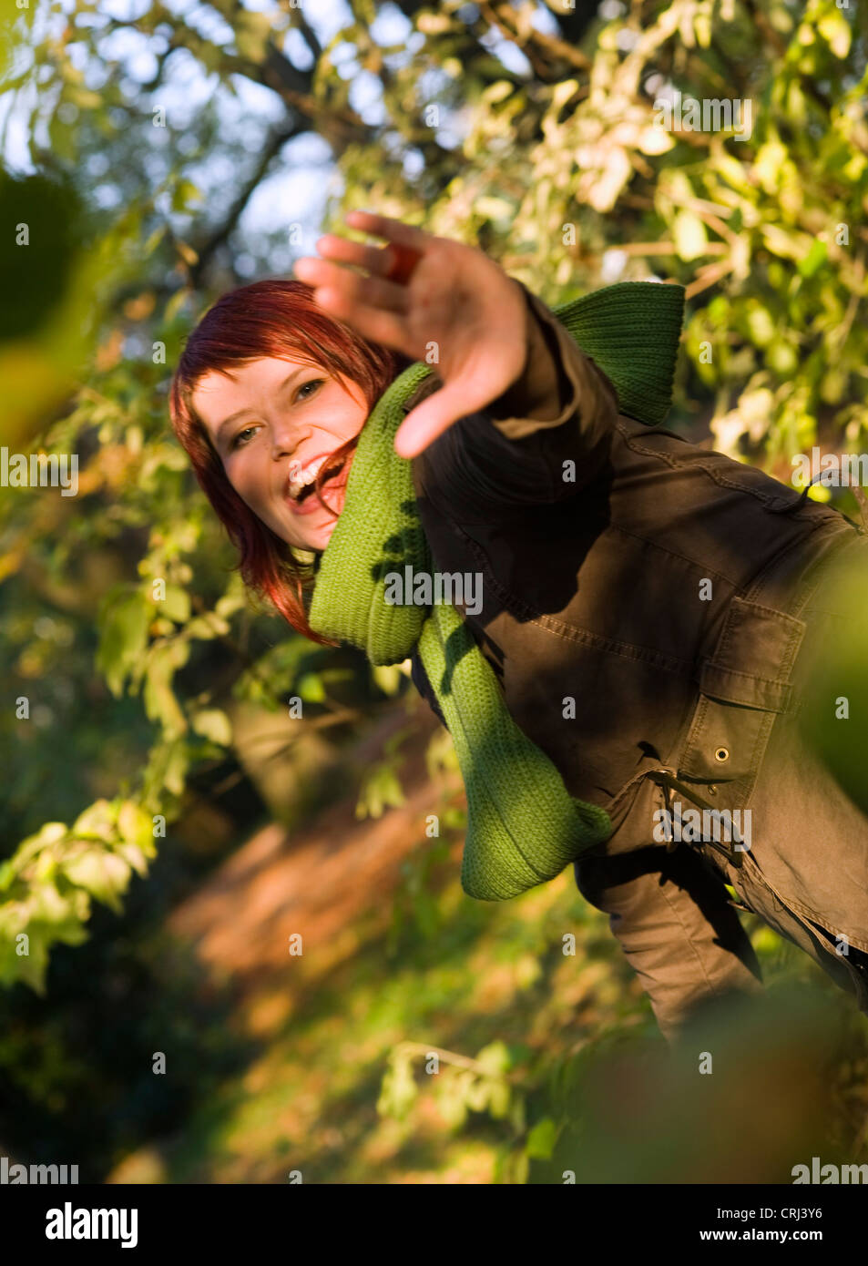 lucky, young woman in autumn - Stock Image