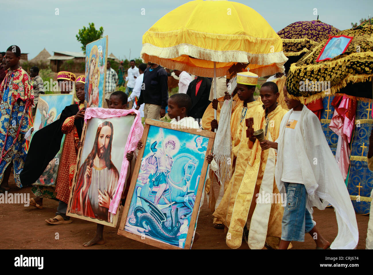 Young boys walking in religious procession. - Stock Image