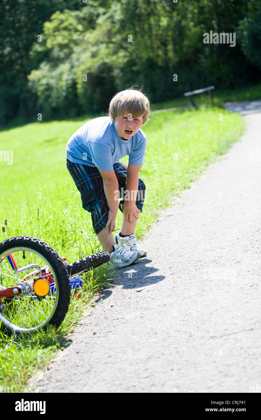 6-year-old boy with a bicycle on the parkway - Stock Image
