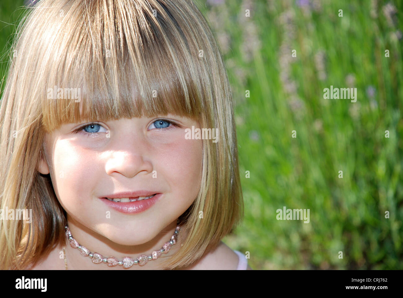 Little Girl With With Straight Blond Hair In Pageboy Style