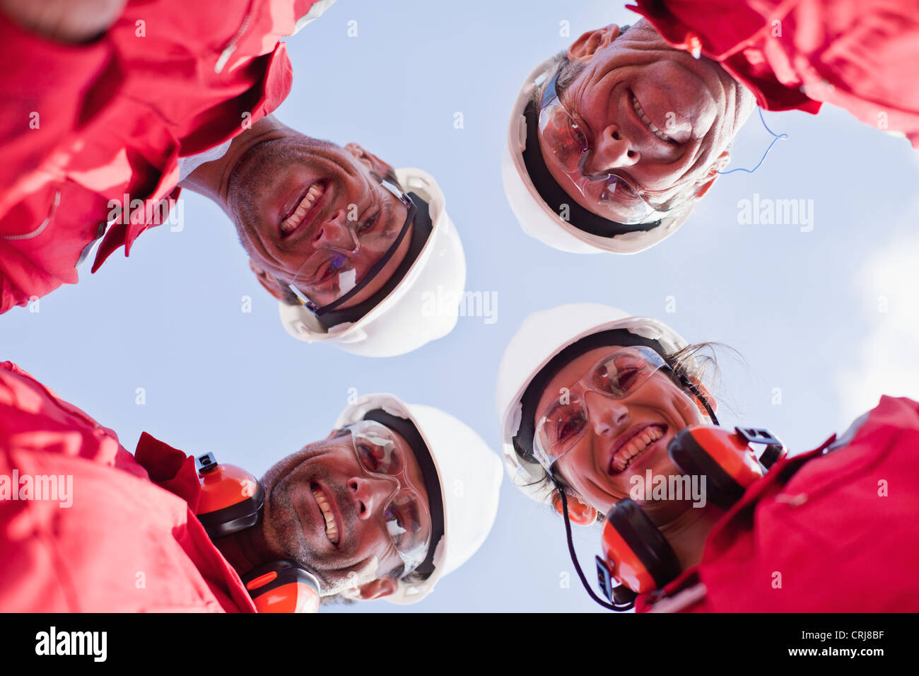 Smiling workers posing outdoors - Stock Image