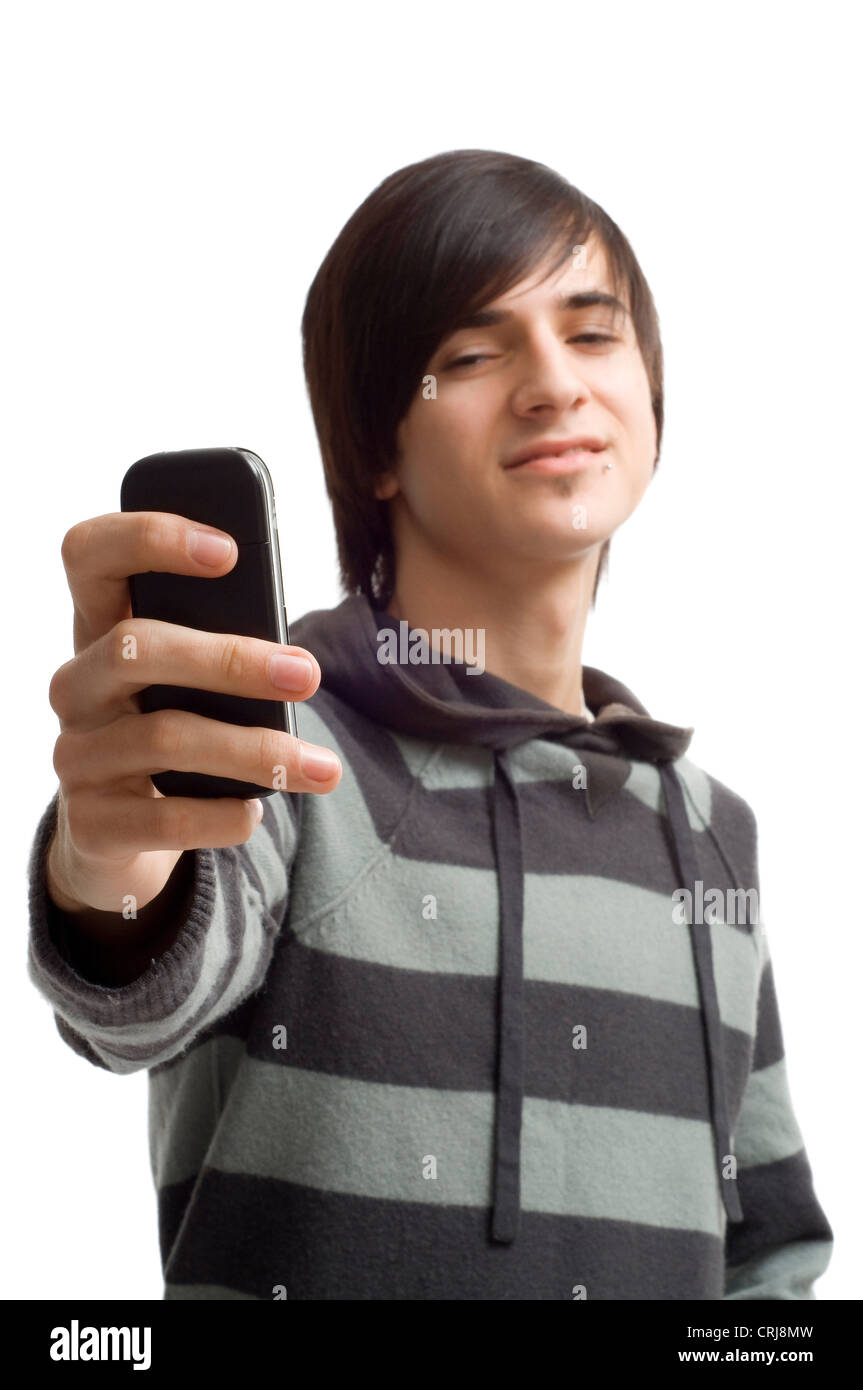 Teenager making a foto from himself with mobilephone - Stock Image