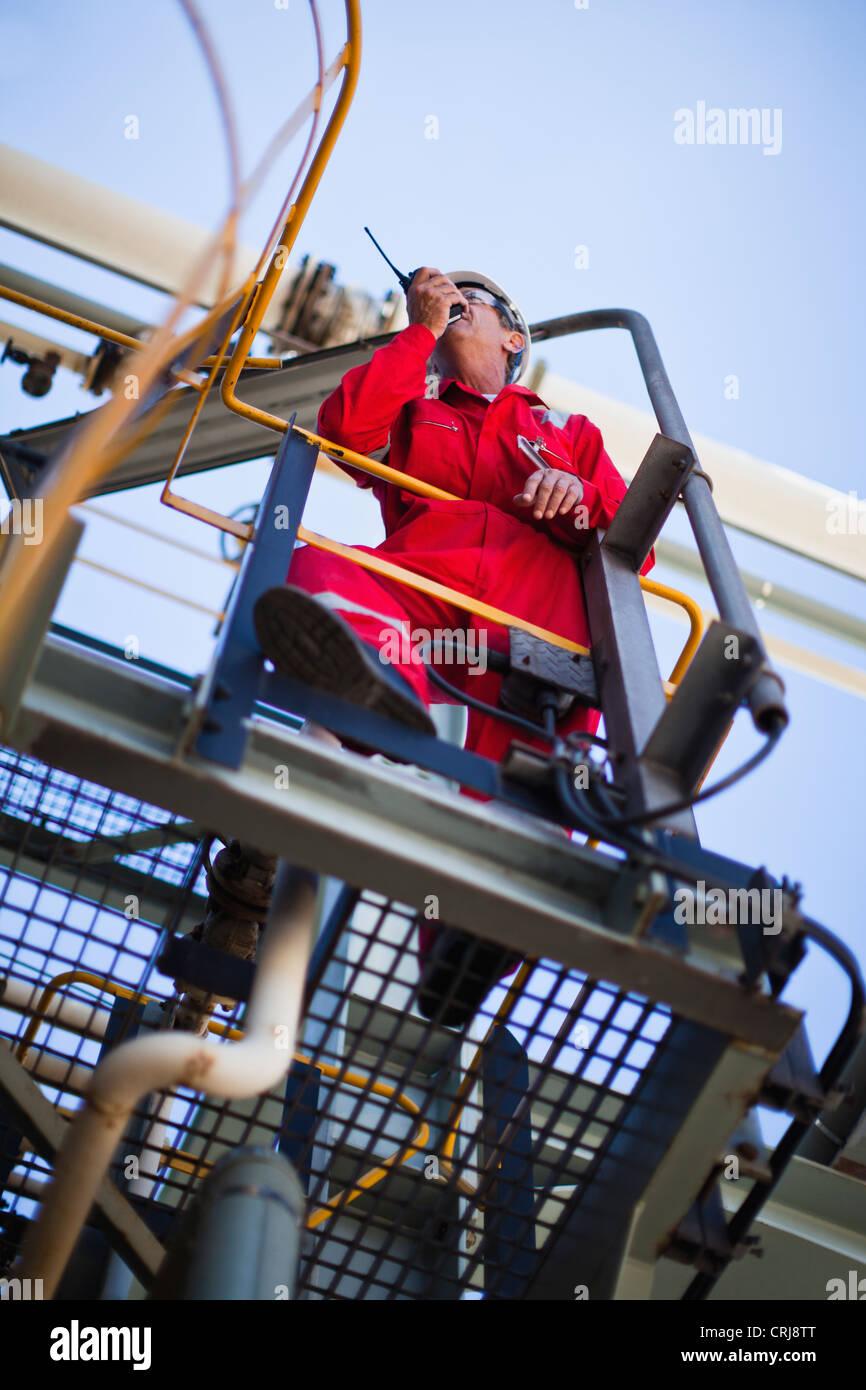 Worker using walkie talkie on site - Stock Image