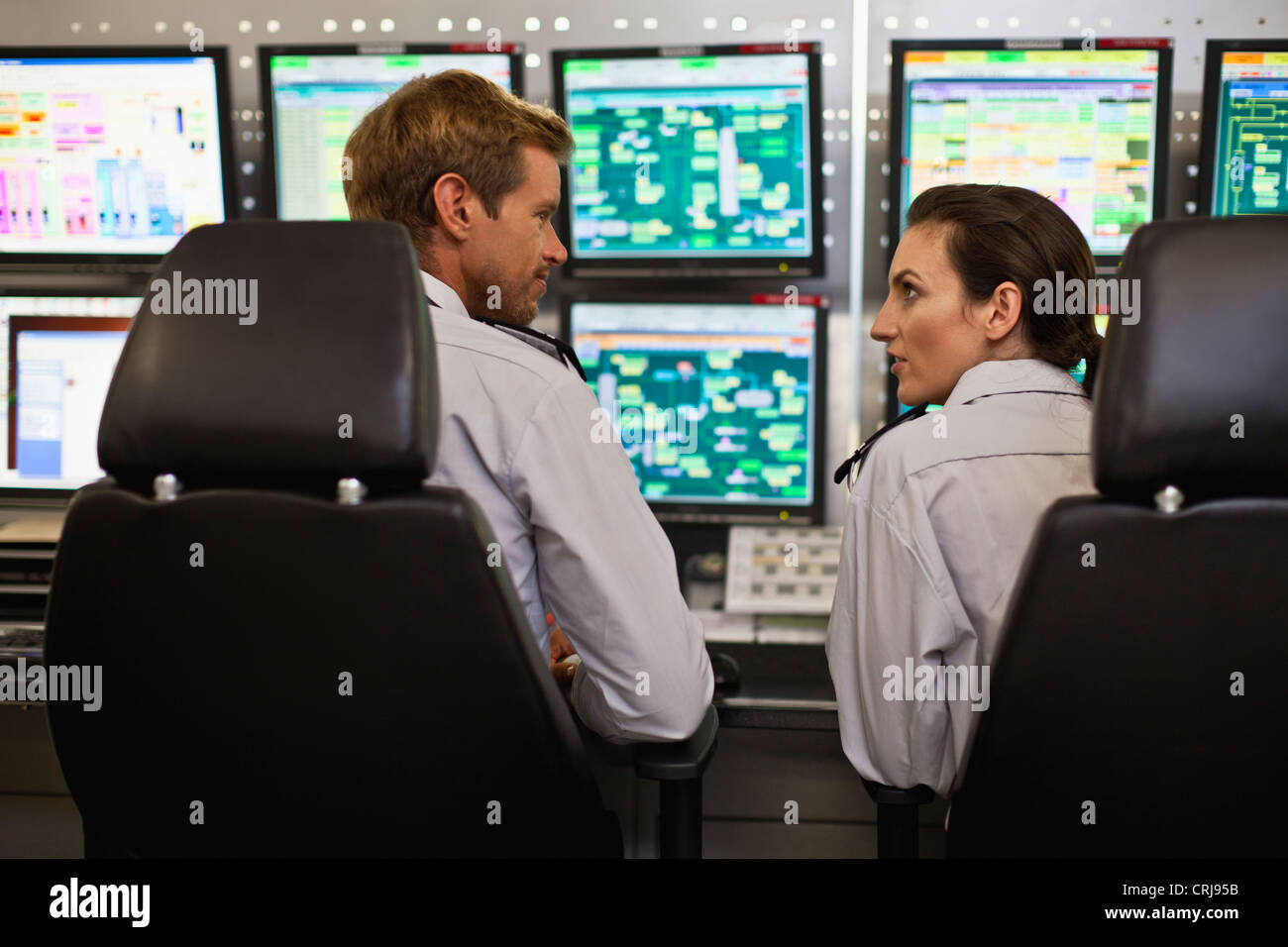 People working in security control room - Stock Image