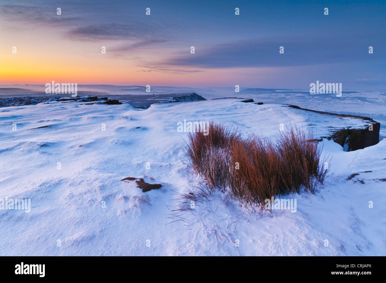 Snow early morning on Froggatt edge Derbyshire Peak District National park Calver England UK GB Europe Stock Photo
