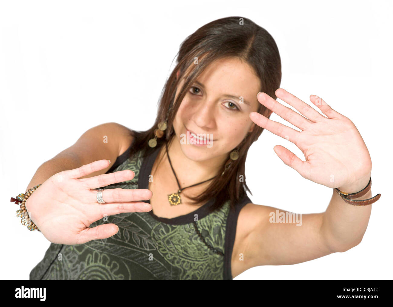 young girl pressing the palm of both hands against the invisible glass pane between her and the camera - Stock Image